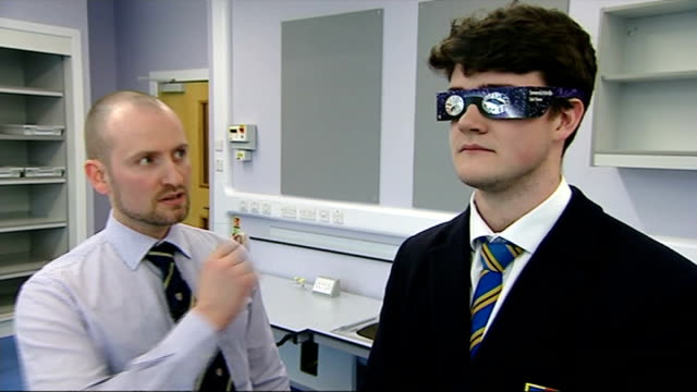 tips on how to view solar eclipse tim browett interview with pupil wearing solar glasses beside and pupils demonstrating pin hole cameras sot tips... - solar eclipse glasses stock videos and b-roll footage