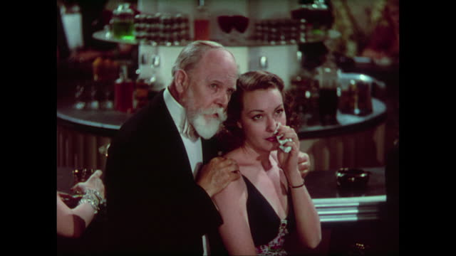 1937 tipsy woman (carole lombard) makes packed casino cry - evening meal stock videos and b-roll footage