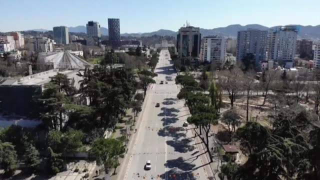 tirana police enforce a new 6pm to 6am curfew in albania who has been taking drastic measures to prevent further spread of the coronavirus within its... - tirana stock videos & royalty-free footage
