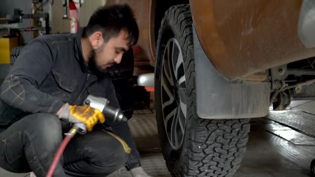 tire changing at car service - mechanic stock videos & royalty-free footage