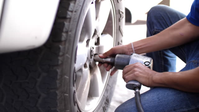 tire maintenance and changing service , slow motion - pierced stock videos & royalty-free footage