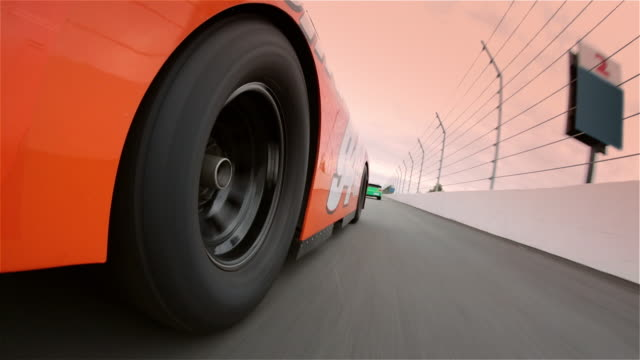 vídeos y material grabado en eventos de stock de tire spins as orange stock car barrels down race track. - piloto