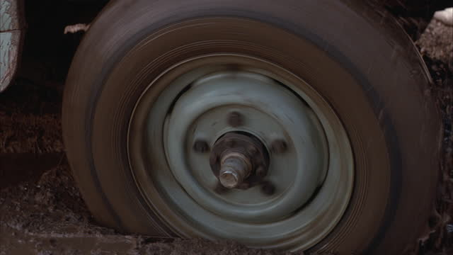 a tire spins in the mud. - mud stock videos and b-roll footage