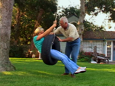 tire swing - tyre swing stock videos & royalty-free footage