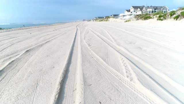 tire tracks along a groomed beach - beach house stock videos & royalty-free footage
