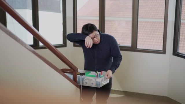tired asian man removing his sweat while he carry a box and walking on the stair for moving house or office concept - exhaustion stock videos & royalty-free footage