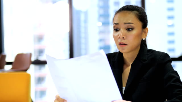 tired business woman suffering work stress wasted worried busy in office. - disappointment stock videos & royalty-free footage
