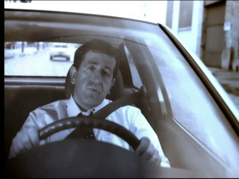 tired businessman driving car on city street - one mid adult man only stock videos & royalty-free footage