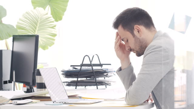 tired businessman in office - emotional stress stock videos & royalty-free footage