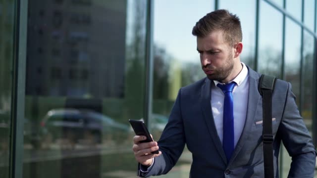 tired businessman text messaging while returning from work - full suit stock videos & royalty-free footage