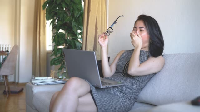 tired businesswoman yawning at home office - mini skirt stock videos & royalty-free footage