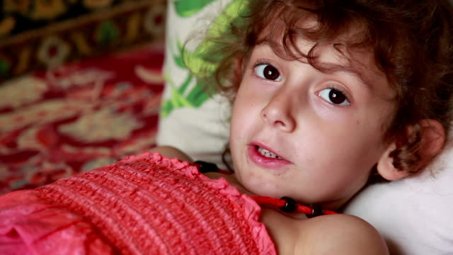 tired child lying in bed - curly hair stock videos & royalty-free footage