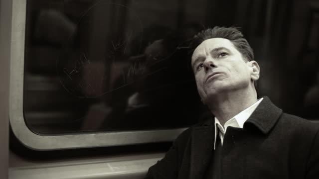 Tired man on subway train