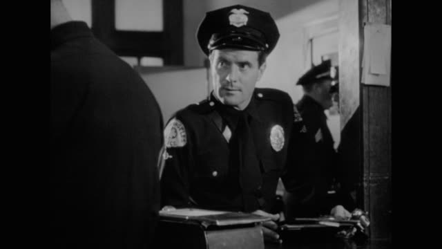 1948 tired police officer hopes to end a long day - film noir style stock videos and b-roll footage