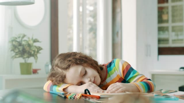 tired school girl sleeping on her books. - one girl only stock videos & royalty-free footage