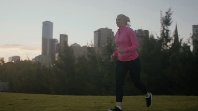 tired senior runner (slow motion) - leisure activity stock videos & royalty-free footage