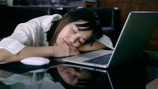 tired woman sleeping at work - laziness stock videos & royalty-free footage