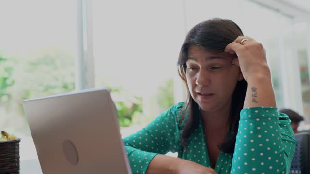 tired woman working at home - mature women stock videos & royalty-free footage