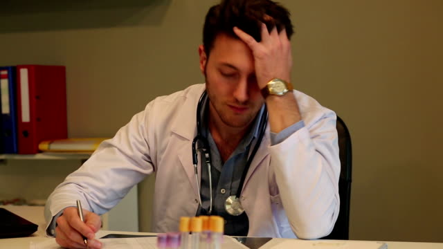 tired young doctor working with stress - assistant stock videos and b-roll footage