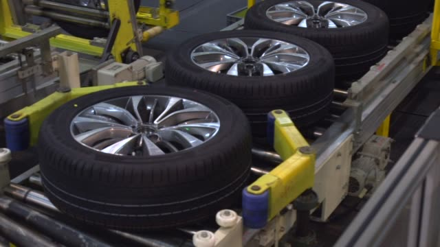 Tires for Trumpchi brand sport utility vehicles move along a conveyor on a production line at the Guangzhou Automobile Group Co Ltd plant in...