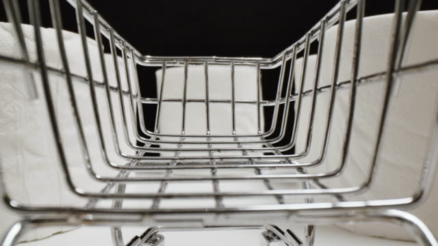 tissue paper on shopping shelf around shopping cart, panic buying concept - tissue paper stock videos & royalty-free footage