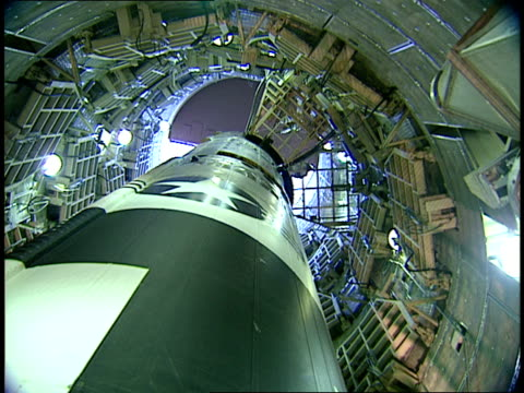 vidéos et rushes de a titan ii missile stands in its underground silo. - silo