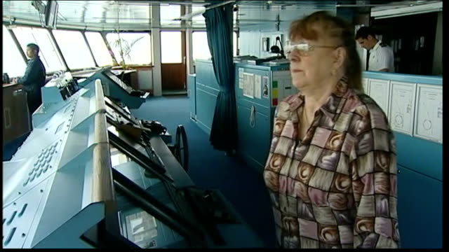 Titanic wreckage site to get UNESCO protection NORTH ATLANTIC At Sea INT Sharon Willing standing chatting to crew member on cruise ship's cabin...