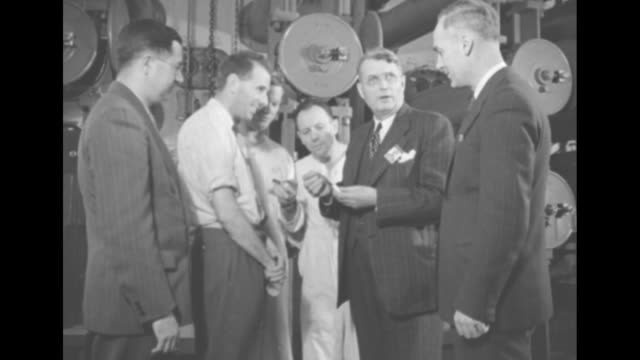 stockvideo's en b-roll-footage met title 1st pictures inside canada's atomic factory superimposed over overhead shot of exterior of chalk river laboratories formerly chalk river... - kernenergie