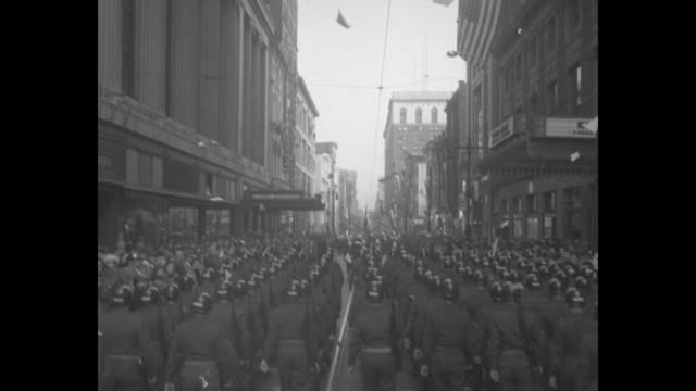 title 28th division sails for germany superimposed over overhead view of soldiers marching in formation down street / ground level view of soldiers... - 1951 stock-videos und b-roll-filmmaterial