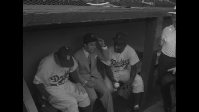 a king at the ball game in brooklyn superimposed over king faisal ii at ebbets field / high angle of the ball park / faisal with mitt and baseball... - ebbets field video stock e b–roll