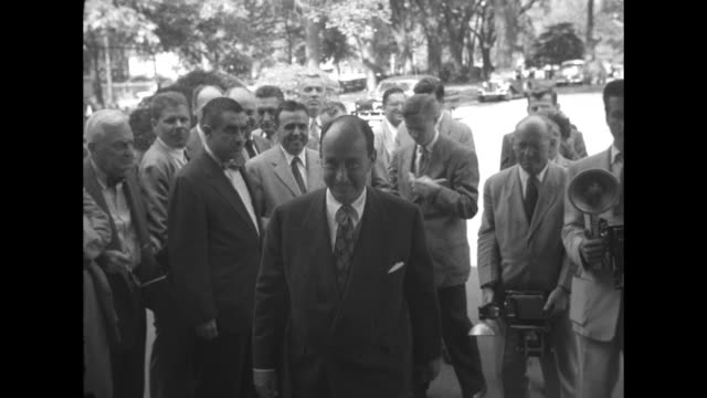 title adlai reports to president on world tour superimposed over adlai stevenson men behind him trees in bg / stevenson men behind him photographers... - adlai stevenson ii stock videos and b-roll footage