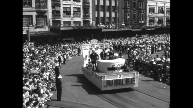 title australia marks 50 years as a unified state superimposed over ws parade along crowded city street / vs high and street shots of parade with... - 1950 stock videos & royalty-free footage