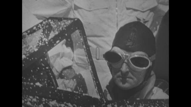 auto racing superimposed over race car bluebird speeding on the bonneville salt flats in ut / sir malcolm campbell sits in race car wearing leather... - bonneville salt flats stock videos and b-roll footage