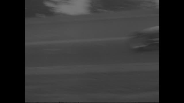 title auto racing superimposed over racetrack at indianapolis 500 / various shots cars racing one driven by bill vukovich / multiplecar crash... - 1955 stock-videos und b-roll-filmmaterial