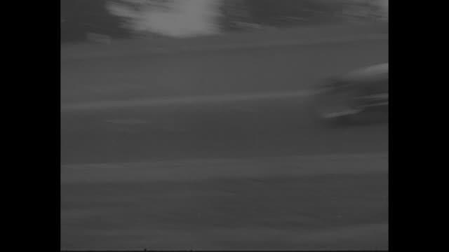 vídeos de stock e filmes b-roll de title auto racing superimposed over racetrack at indianapolis 500 / various shots cars racing one driven by bill vukovich / multiplecar crash... - 1955