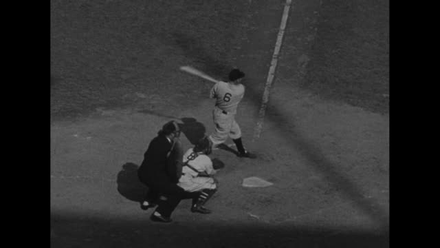 Baseball over four players who turn to reveal one number each on the back of their uniforms which together form 1936 / CU Tony Lazzeri of the New...