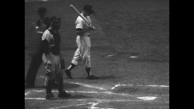 stockvideo's en b-roll-footage met baseball standouts superimposed over game in progress at yankee stadium in new york city / title the man mickey mantle superimposed over new york... - 1956