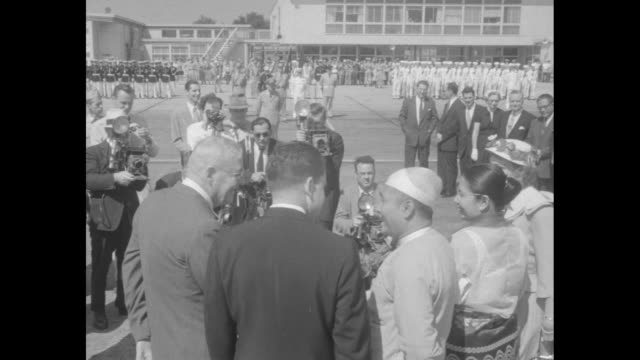 """burma's u nu sees ike on orient issue"" superimposed on view u nu deplaning / u nu is greeted by secretary of state john foster dulles and vice... - nu stock videos & royalty-free footage"