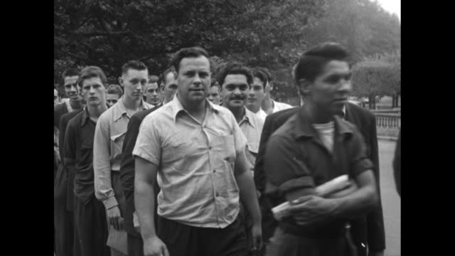 """""""canada enlists special brigade"""" superimposed over recruits standing at long table outdoors being interviewed by solders seated across table / group... - korean war stock videos & royalty-free footage"""