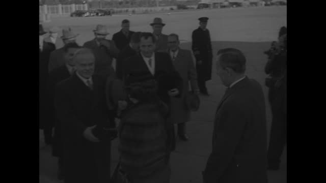 canada's pearson on moscow visit superimposed over canada's minister of external affairs lester pearson and his wife maryon coming down steps from... - vyacheslav m. molotov stock videos and b-roll footage