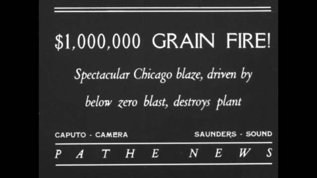 """grain fire! spectacular chicago blaze, driven by below zero blast, destroys plant"""" / night vs wind driven flames consume tall wooden structure, large... - cereal plant stock-videos und b-roll-filmmaterial"""