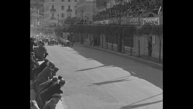 vídeos de stock, filmes e b-roll de 100 times around monaco europe's gasoline demons make thousand turns in grand prix auto race guy moll of italy averages 60 mph to win 200mile grind /... - condição