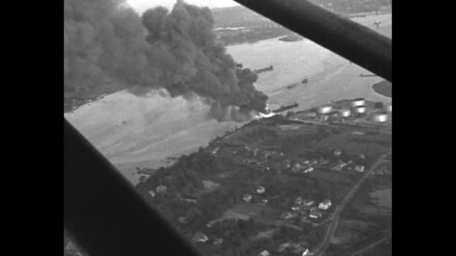 165000 gallons of blazing gas give new york a thrill mystery fire sweeping new jersey waterfront near city menaces 12000 gallons stored in oil tanks... - see other clips from this shoot 165 stock videos and b-roll footage