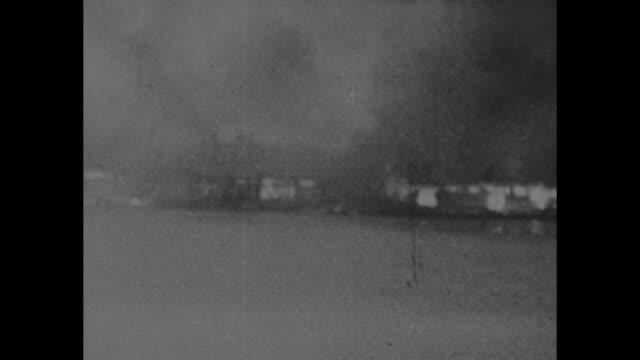 """1st film, dutch fire surabaya before jap capture"" / smoke rising from burning city / two shots of buildings near shore burning / three shots of... - surabaya stock videos & royalty-free footage"