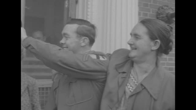 1st pow who quit reds comes home superimposed over corporal edward dickenson exiting walter reed army medical center and hugging his mom dickenson is... - end cap stock videos & royalty-free footage
