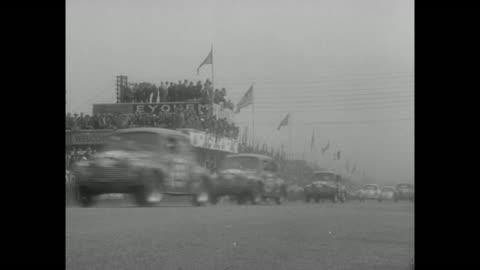 """hour sports car marathon!"""" superimposed over cars on race track / vs cars racing along track, stands filled with spectators / from pit as cars race... - mercedes benz markenname stock-videos und b-roll-filmmaterial"""