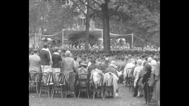 241 cadets join army as officers West Point NY Sec'y of War Hurley presents diplomas at Military Academy exercises / VS large crowd seated on...