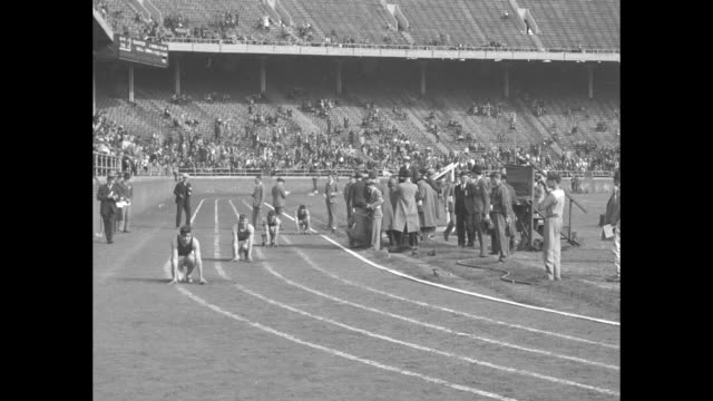 3000 Track Stars Shine in Penn Relays / MS runners on their mark at Franklin Field starting pistol is fired runners take off / LS tilt down runners...