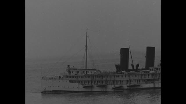 500 saved after ship is wrecked on dangerous reef crowded coastal steamer harvard goes aground off point arguello calif / people on shore looking out... - steam liner stock videos & royalty-free footage