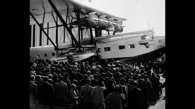 '50Passenger Plane Washington Yankeebuilt plane for South American service Mrs Hoover christens world's largest amphibian' / crowds surround seaplane...
